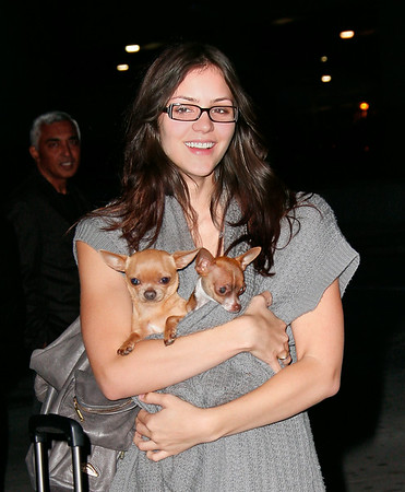 Katharine McPhee and fiancee Nick Cokas arrive to JFK Airport.  Katharine can be seen wearing an engagement ring as she arrives with her two puppies in tow.