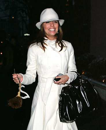 Eva Longoria, after visiting the Christmas tree at Gramercy Park, walks out holding the exclusive key to the Park looking very happy.  Gramercy Park is a private park, one of only two in New York City, to which only people residing around the park have a key.