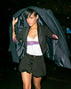 9 April 2008 - New York, NY - Rihanna wears a shirt that says 'Eye Need Flash Nerds' while out with Chris Brown in the rain after her benefit concert at Highline Ballroom.   Photo Credit Jackson Lee