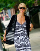 14 June 2008 - New York, NY - Heidi Klum out and about in NYC in a printed dress and skull tote bag.  Photo Credit Jackson Lee
