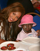 Beyonce Knowles holds up cookies decorated with Destiny's Child names and poses with kids undergoing treatment at the Ronald McDonald House NYC - July 30, 2005<br /> NO US