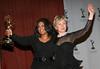 21 November 2005 - New York, NY - Oprah Winfrey, recipient of the Founder's Award and Senator Hillary Rodham Clinton, presenter of the Founder's Award at 2005 International Emmy Awards at the New York Hilton.  Photo Credit Jackson Lee