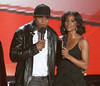 """1 March 2006 - New York, NY - LL Cool J and Gabrielle Union at BET's """"Rip the Runway"""" Fashion Show.  Photo Credit Jackson Lee/Admedia"""