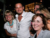 14 June 2006 - New York, NY - Justin Chambers poses with fans at Delta Jet-Set Summer event at Henri Bendel.  Photo Credit Jackson Lee