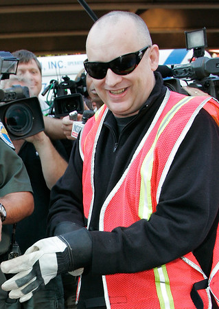 14 Aug 2006 - New York, NY - Boy George (aka George O'Doud) sweeps the streets of New York's Chinatown to serve his community service sentence.  Here he is pictured donning work gloves.  Photo Credit Jackson Lee