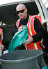 14 Aug 2006 - New York, NY - Boy George (aka George O'Doud) sweeps the streets of New York's Chinatown to serve his community service sentence.  Here he is pictured helping to put garbage bags on the trash bins that he has been assigned to use.  Photo Credit Jackson Lee