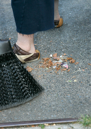 14 Aug 2006 - New York, NY - Boy George (aka George O'Doud) sweeps the streets of New York's Chinatown to serve his community service sentence.  Pictured are street debris that he sweeped up.  Photo Credit Jackson Lee