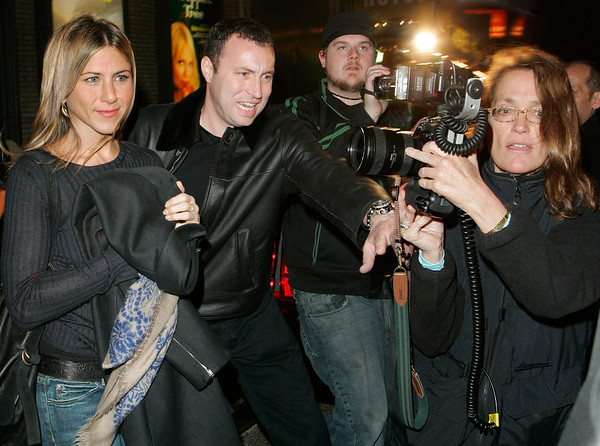 23 Oct 2006 - New York, NY - Jennifer Aniston departs from the '6th Annual 24 HOUR PLAYS on BROADWAY', a one-night benefit for Working Playground at the American Airlines Theatre.  The paparazzi photographer in the foreground is Andrea Renault from Globe Photos.  Photo Credit Jackson Lee/Brian Prahl/Jennifer Mitchell/Splash News<br /> <br /> LJNY BPNY MJNY 23 10 06