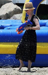 Water fight! January Jones Sprays Friends With A Water Pistol In Malibu, CA