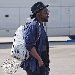 EXCLUSIVE: will.i.am Listens To His Music With An Unusual Speaker Bag and Headphones in LA!