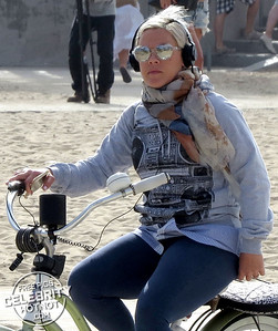 EXC: Pink Cycles In Love Heart Sunglasses And A Boombox Sweater!