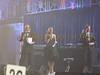 Simon du Pury (left) conducts live auction