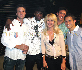 Ryan Klarberg, 50 cent, Sara Herbert-Galloway, Evan Reshev, and Jason Krochak from the University of Michigan congratulating 50 cent on a great performance