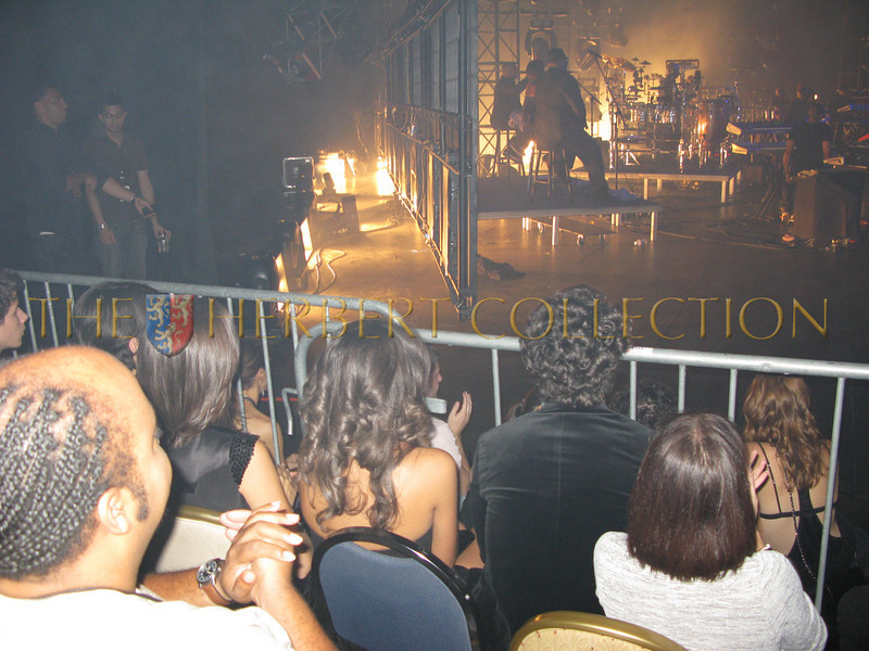 Back Stage while Jonas Brothers look on