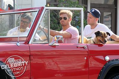 EXC: Kellan Lutz Takes Dog, Kola, For Ride In Red Ford Bronco