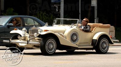 EXC: Arnold Schwarzenegger In Classic 'Excalibur Roadster', LA