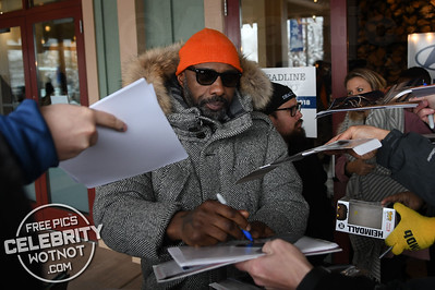 You Just Can't Miss Idris Elba In His Bright Orange Beanie And Burberry Parka!