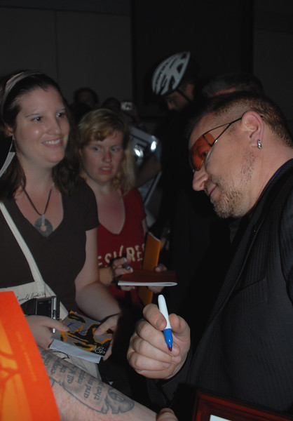Bono signs a fans arm so he can tatoo the signature.  Bono was in Philadelphia to recieve the Liberty Medal award and a $100,000 check towards his charity DATA.