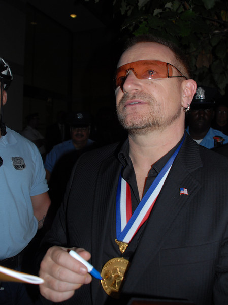 Bono signs autographs for fans as he departs the Constitution Center in Philadelphia, PA after receiving the 2007 Liberty Medal and a check for $100,000 for his charity organization DATA