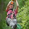 Melissa Arreola zips through the forest on Denali Zip Line Tours, Talkeetna.  Royal Caribbean and Celebrity Cruises Alaska Excursions.
