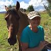 Judy w horse in Katie's pasture