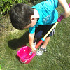 Nate is filling up his squirt gun to water the flowers