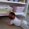 Emma straightening up her cupboards