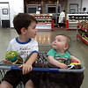 grocery shopping<br /> Emma just adores her brother