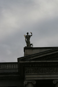 A close-up of a statue on a building.