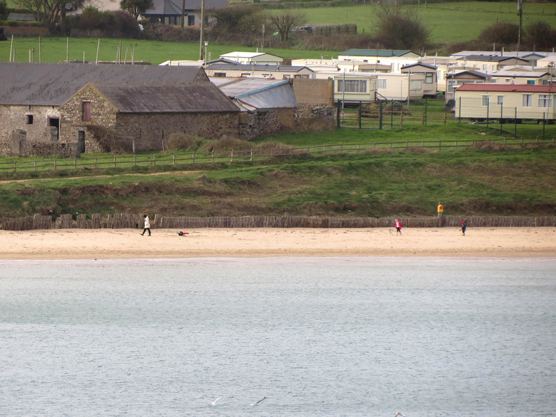 Looking at the beach with a zoom lens from St Declan's well.