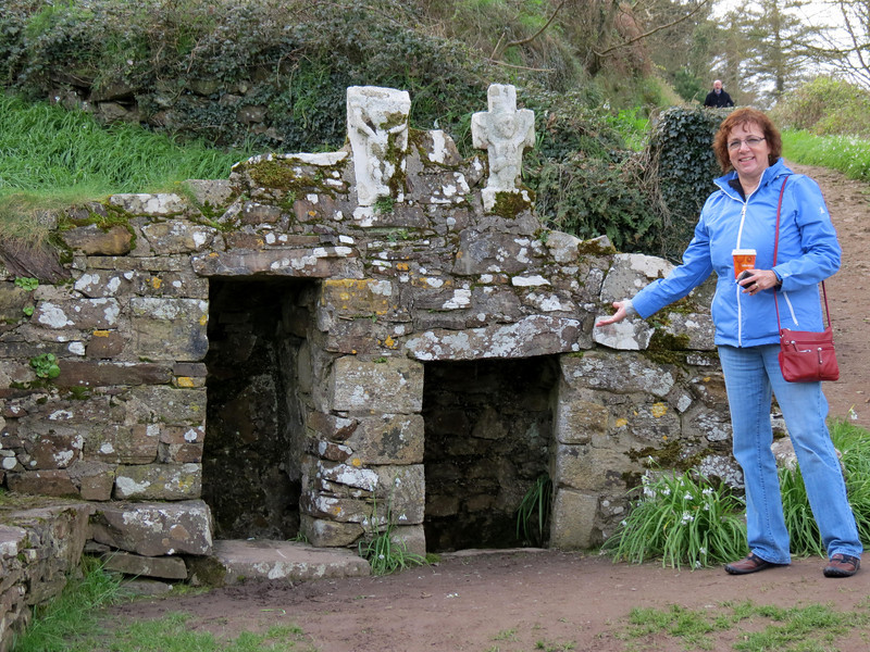 You walk up that path behind me and find St Declan's well.