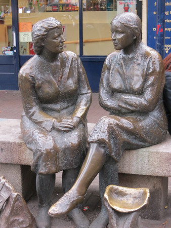 """Dubliners name their statues - this one is outside a woollen shop - it's called """"The Hags with the Bags""""."""