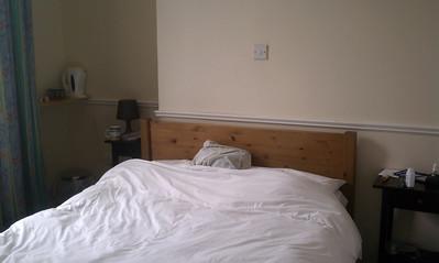 Bed, 2 night stands, tea in the corner.