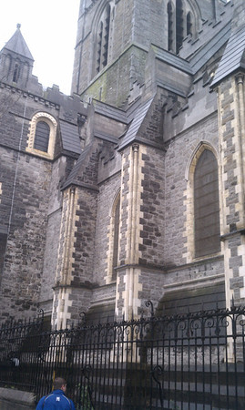 The back of Christ Church Cathedral with a person in it so you can see how tall it is.