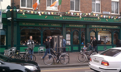 Dan standing outside the Kingfisher where Kathie had breakfast and he had lunch.  Now with St Patrick's Day decorations.