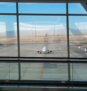 Heading to the gates at DIA - going over the walkway to concourse A.  You can see our Irish spirits in the window.