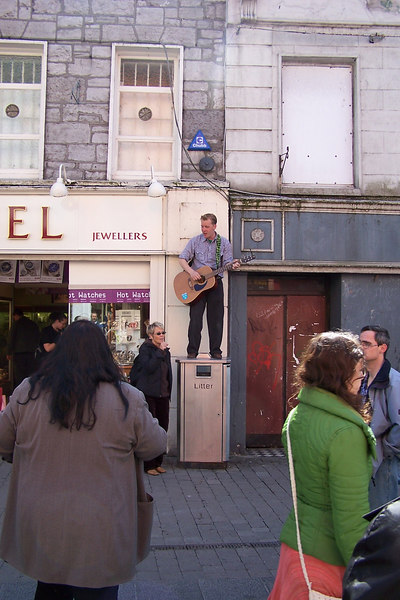 Galway street singer on litter bin