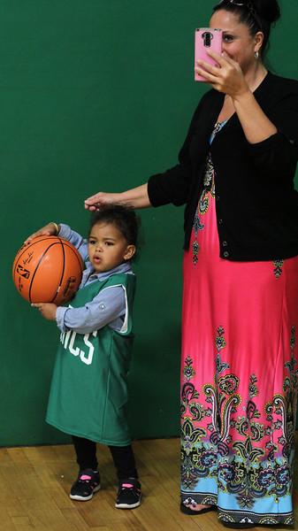 Lynn, Ma. 5-24-17. Alayna Jimenez, child, and Tobatha Mello watch the basketball cllinic  put on by the boston Celtics at the Lynn YMCA