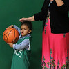 Lynn, Ma. 5-24-17. Alayna Jimenez, child, and Tobatha Mello watch the basketball cllinic  put on by the boston Celtics at the Lynn YMCA