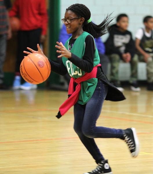 Lynn, Ma. 5-24-17. Sandra Sholola during dribbling practice at a Celtics basketball clinic at the Lynn YMCA
