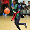 Lynn, Ma. 5-24-17. Sandra Sholola during dribbling practice at a Celtics basketball clinic at the Lynn YMCA