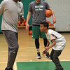 Lynn, Ma, 5-24-17. Boston Celtic legand Leon Powe, left, works out with Dahrien Bernabel at a basketball clinic held at the Lynn YMCA.