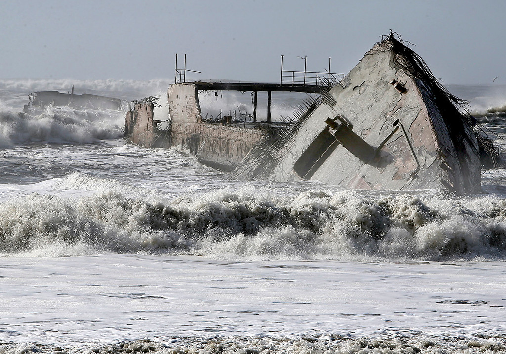 . The SS Palo Alto is engulfed by the sea at Rio Del Mar in Aptos on Saturday after powerful waves broke the stern from the rest of the boat. (Kevin Johnson -- Santa Cruz Sentinel)