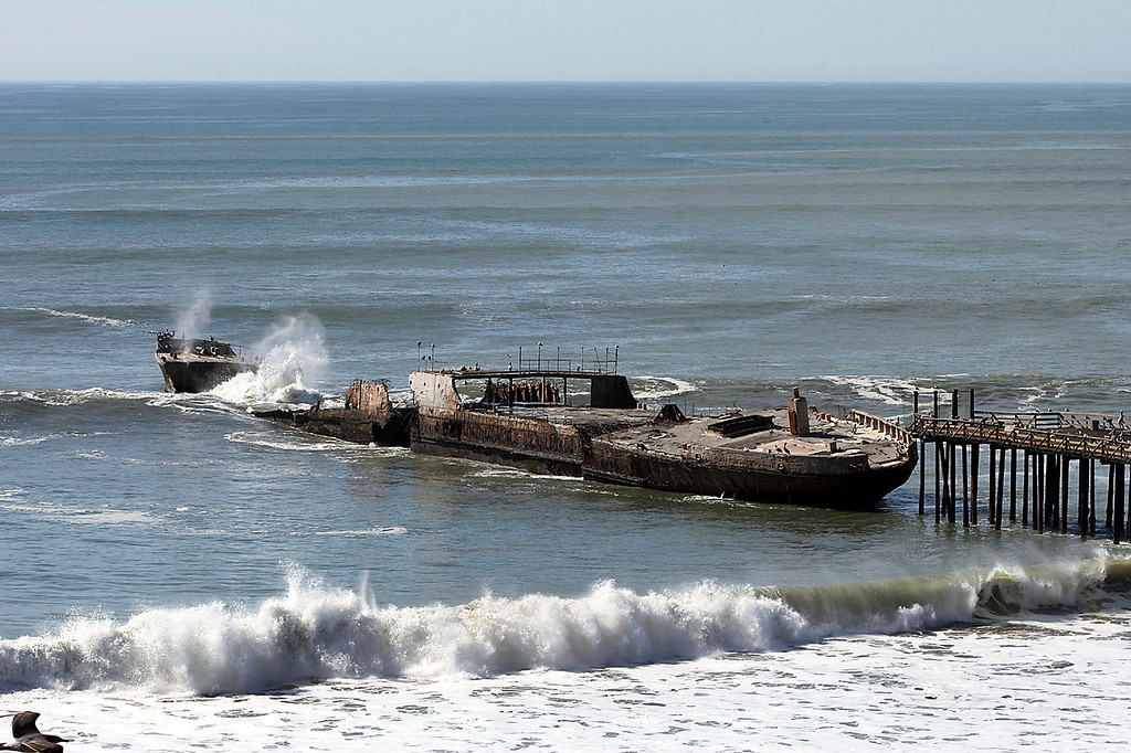 . The SS Palo Alto cement ship bow shifts and continues to break up as it gets hit by large waves Thursday, Feb. 4, 2016, in Aptos, Calif. Recent El Nino storms are battering the landmark concrete ship long ago beached on the California coast, officials said Wednesday. This winter\'s especially powerful surf has shifted part of the fractured SS Palo Alto, causing pieces of it to break off and fall into the pounding waves. Officials say they have no plans to stop the erosion that will eventually turn the ship into habitat for sea life. (Dan Coyro/Santa Cruz Sentinel via AP)