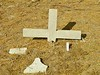 Do you agree that it is best to re-insert the remnant of a broken cross in the ground?
