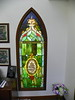 The stained glass windows in the office are from the St. Boniface Catholic Church of 1902.