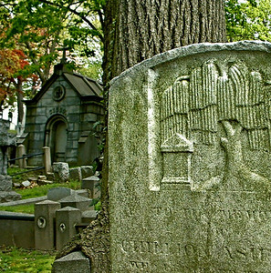 Headstone with willow tree symbol at Trinity Church Cemetery & Mausoleum, NYC.