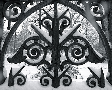 Fence in winter at Trinity Church Cemetery & Mausoleum, NYC.