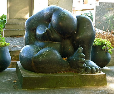 "The grave of French sculptor Henri Laurens (1885-1954), marked by his own work, ""La Douleur"" (Grief). Montparnasse Cemetery, Paris."