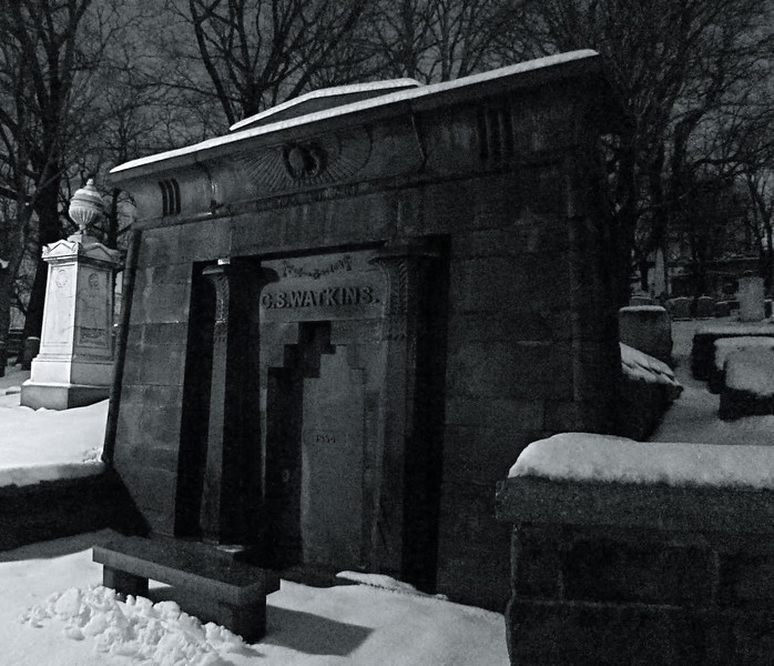 Snow highlights an Egyptian-Revival mausoleum in Trinity Church Cemetery.
